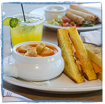 Classic Grilled Cheese buttery, Texas toast, American and cheddar cheese served along slide Creamy Tomato Soup